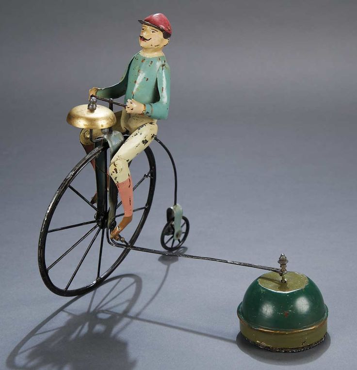 French Painted Tin and Iron Toy Featuring Early Bicyclist circa late 1800s Sold $1800.