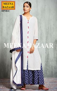 Look smart and lavish with this Offwhite salwar suit. Featuring cotton lotus printed hand embroidered sleeveless inner and crinkle chiffon front open 3/4 sleeves kurta. Hand embroidered mirror button with silk thread tassels. Comes with chikankari with mukaish embroidery.