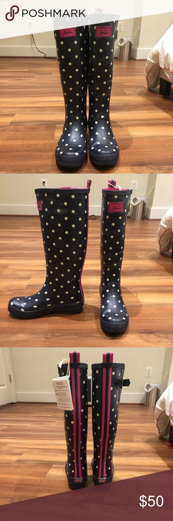 Joules Size 9 Wellies Navy blue with white polka dots and hot pink accents. Never worn!!! Adjustable calf width. Joules Shoes Winter & Rain Boots