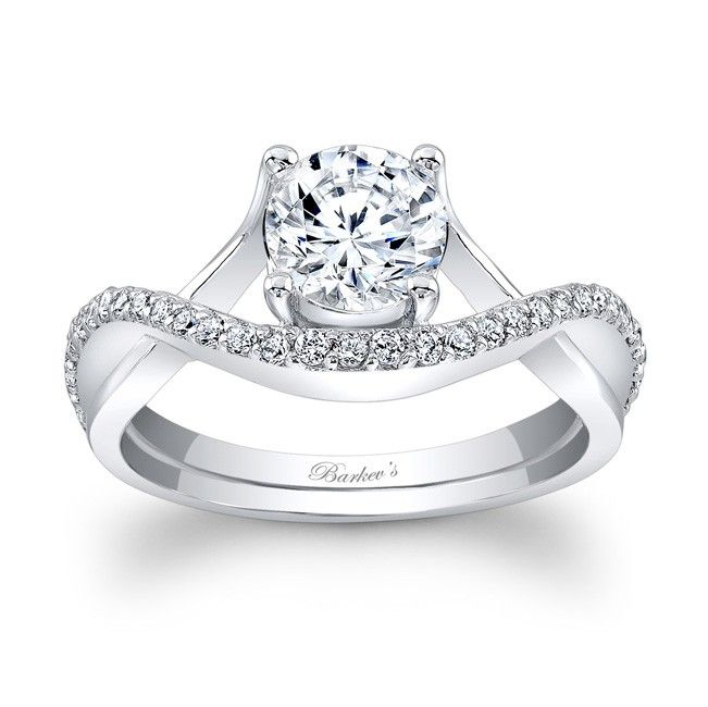 Engagement Ring - 7913LW - Dramatic, sure to catch the eye of many admirers this diamond engagement ring is artfully designed with split crossing shoulders forming the prongs on one side and a pave set diamond ridge that cradles the prong-set round center diamond on the other side for an added touch of elegance.