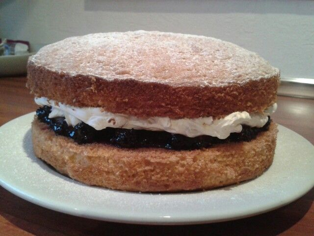 Victoria sandwich with homemade blackberry jam and whipped fresh cream. Delicious