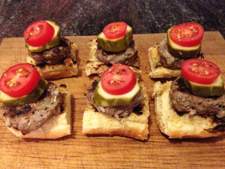 """THUMB BITS"" - a variation of garlic beef medallions on melba toast with a pickle on top, the original version inspired by Pebbles restaurant. This version adds lemongrass."