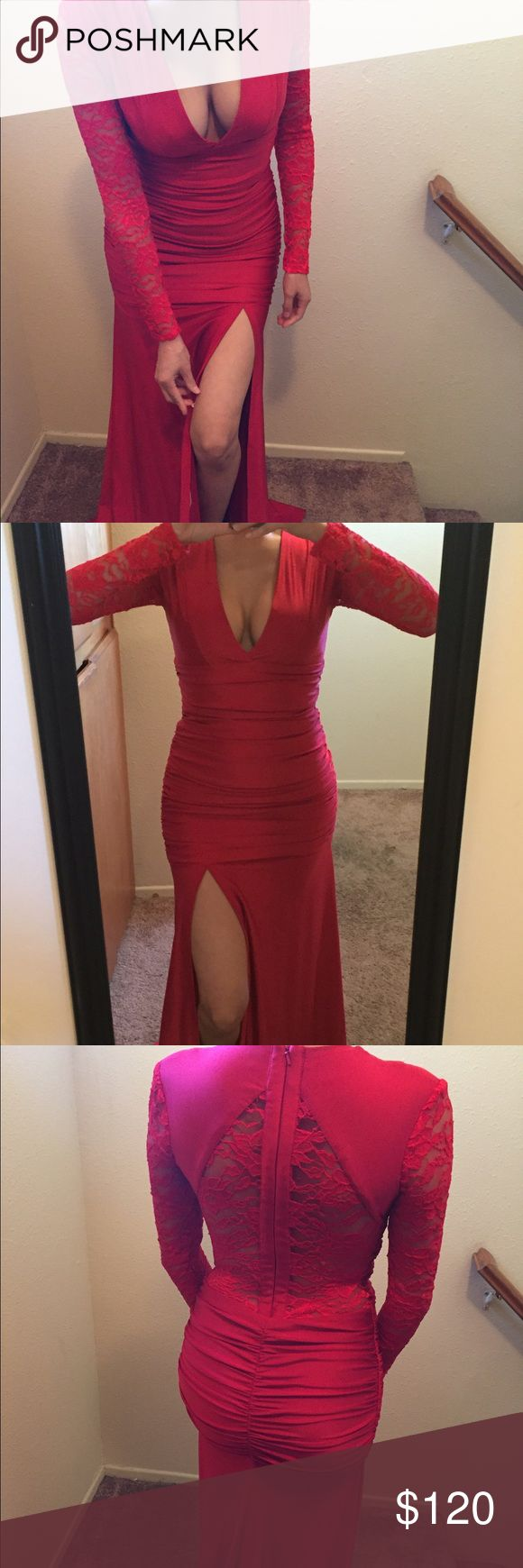 Red long sleeve dress Perfect for a cold weather! The dress is bright red , very stretchy material, it molds the body , the back and sleeves are lace , one high leg slit , made in USA , the material is thick , definitely a show stopper, picture does no justice atria Dresses Prom
