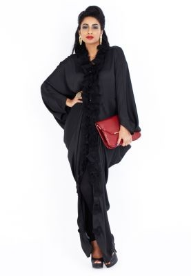 Redefine fashion with this gorgeous silk Abaya by Rouge Couture! Features front petal detailing and pearl buttons for that glam appeal. Now available via www.namshi.com
