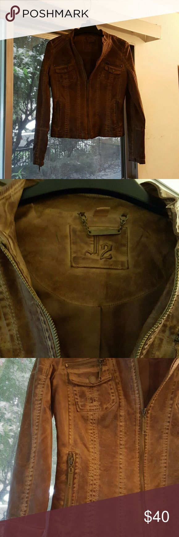 Brown leather jacket   (  NWOT ) Distressed brown leather  motorcycle jacket , with zippers on pockets .  Brand new , never worn , bought it cause its SO CUTE . I just outgrew it . J2 Jackets & Coats