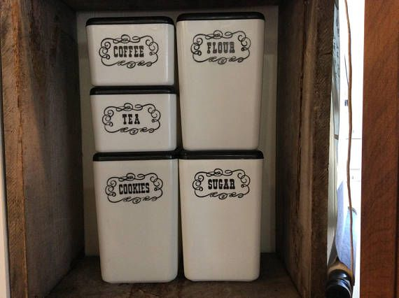 5 piece black and white plastic retro canisters