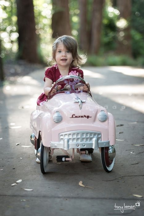 The little pink car - Our cute retro vintage car is available for location shoots and is suitable for children between the ages of 10 months to 7 years.   Photograph sessions available between Brisbane and Sunshine Coast.  Brisbane freelance photographer Tony Leman