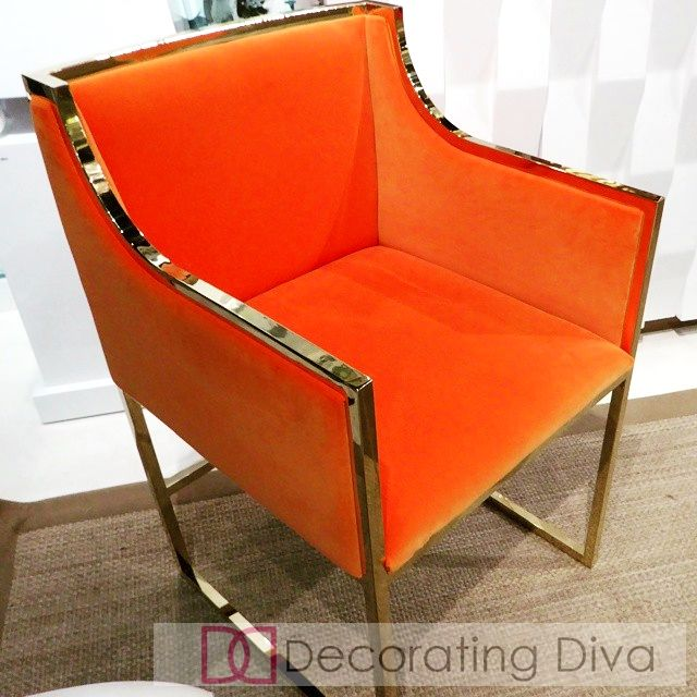 Orange Chair With Brass Trim.