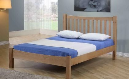 5ft Milano Solid Oak Bed Frame - £399.95 - This is a fantastic solid oak bedstead in a luxury clear wax finish, you will not find any veneer here, it really is a solid oak frame. The beds main feature is its sleek low foot end design. The bed frame uses a sprung slat system