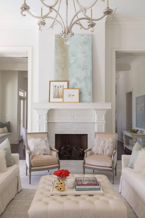 Beige And Blue Transitional Living Room Features An Oslo Chandelier Illuminating A Pair Of Light