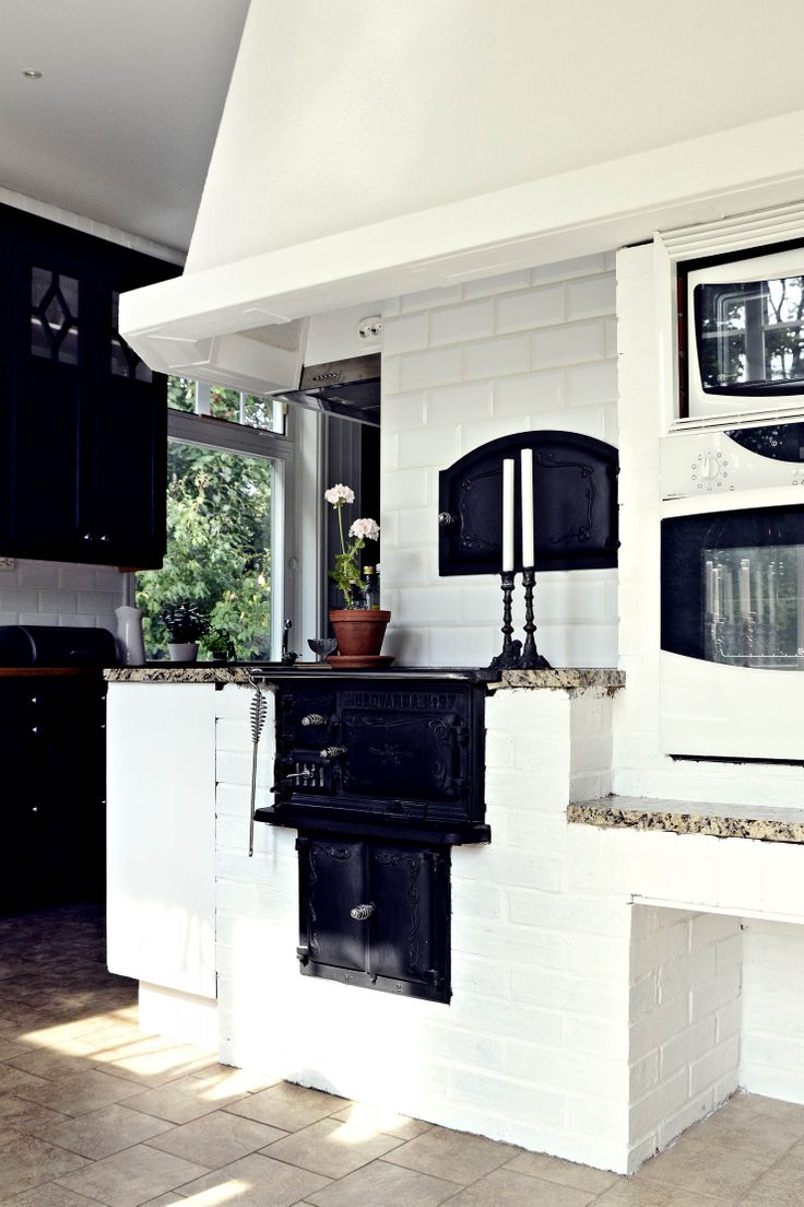 Old Swedish cast iron cocking stove in modern kitchen