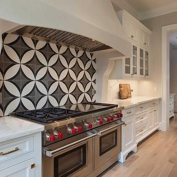 Need a remodeling kitchen idea? Do you want a beautiful Victorian Kitchen? We got you covered in creating your dream house. Check out this Kitchen Cooktop with Black and White Cement Circle Backsplash Tiles.