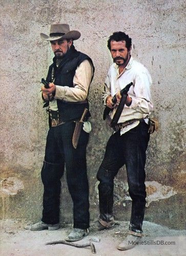 THE WILD BUNCH (1969) - The notorious Gorch Brothers (Ben Johnson & Warren Oates) are armed and ready to do battle with the Mexican military - Directed by Sam Peckinpah - Warner Bros. - Publicity Still.