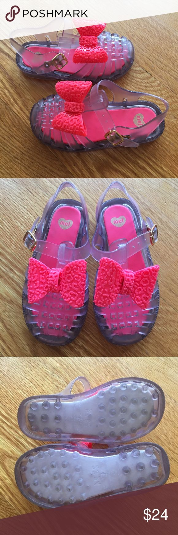 Mini Melissa Pink Bow Sandals Size 9 Cute and pretty Mini Melissa clear jelly sandals with pink bows. Excellent condition only worn few times indoors. PVC sandal with lightly cushioned footbed. Made in Brazil. Fruity smell 💕 Mini Melissa Shoes Sandals & Flip Flops