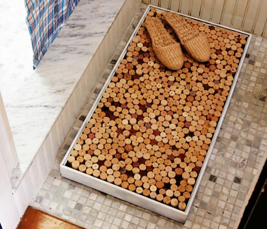 """from the blog Daily Danny (www.dailydanny.com): """"...great DIY bath mat from wine bottles, and a simple frame. Just arrange them vertically, so they're snug, and you're all set."""""""