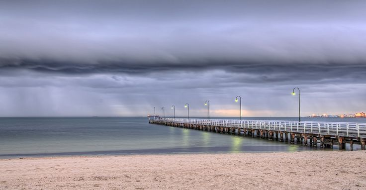 Calm before storm - It was eerily calm at the beach as storm front clouds swept across the bay. Port  Phillip Bay Melbourne Australia