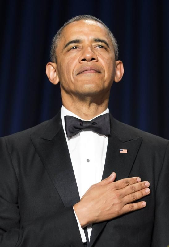 U.S. President Barack Obama stands during the posting of colors at the White House Correspondents' Association Dinner in Washington May 3, 2014