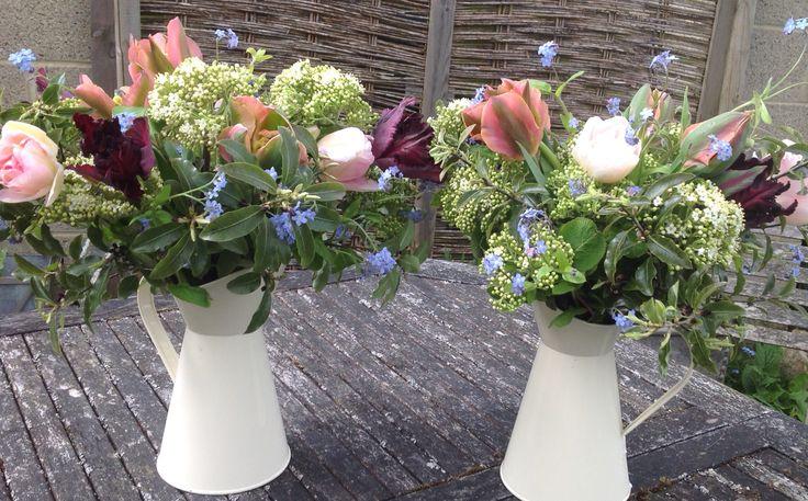 April tulip jugs by Gathered Garden https://www.facebook.com/gatheredgarden/posts/565115590293988