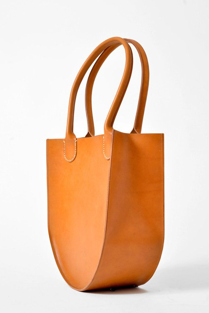 Sara Barner Leather Russell Tote - Tan. 13 x 14 x 5 in. English Bridle leather; one inside pocket; hand stitched rolled handles