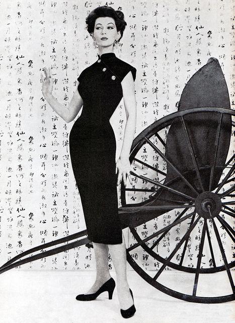 Dovima, 1955. Japanese inspired black dress.