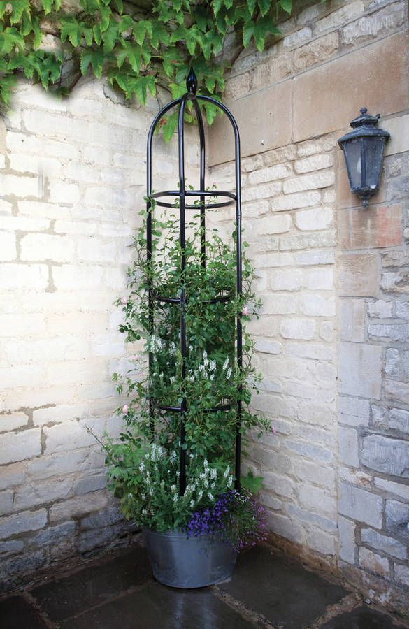 Minster Black Metal Garden Obelisk. A charming and classically styled obelisk great for climbing plants. This obelisk will look great wherever it is placed, and is made from durable powder coated stainless steel.