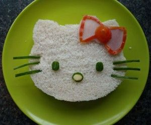 #food cute sandwich for Hello Kitty fans    Ingredients:  2 slices of bread  sandwich filling  slice of ham  cheese  tomato  cucumber    How to make it check link