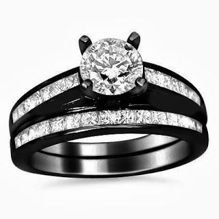 Diamond Engagement Ring Wedding Set This item is a new certified 1.50ct diamond ring and matching band set in 14k black gold (an advanced electroplating solution of black rhodium with stabilizer is applied to the ring for its black finish). A solitaire SI-1 clarity and G color .50ct round diamond is set in the center of the set. Set down its sides and on the band are 1.0ct of princess cut channel set diamonds. They are excellent quality SI-1 - SI-2 clarity and G color.