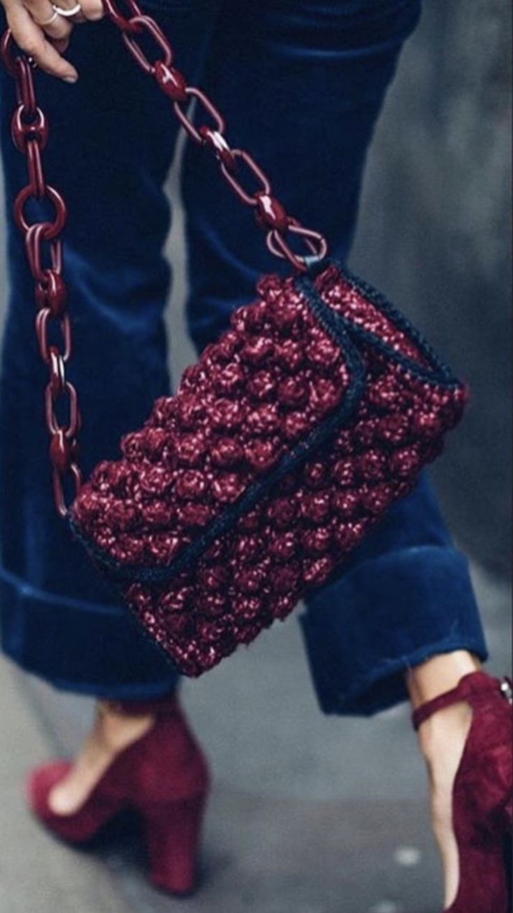 Maroon and black bag with chain.