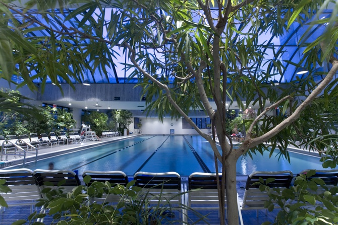For a little luxury, try this hotel rooftop pool with a retractable glass roof. Day passes include the use of the gym, saunas and whirlpool but are only offered Monday through Friday, no weekends or holidays. The cost is $35.12 per person.  Worth it in this heat!