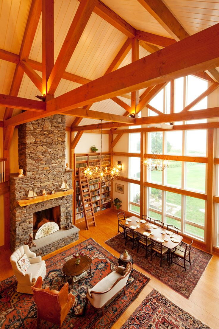Yankee Barn Homes, love the bookcase and fireplace. Lots of dining space for big family meals.