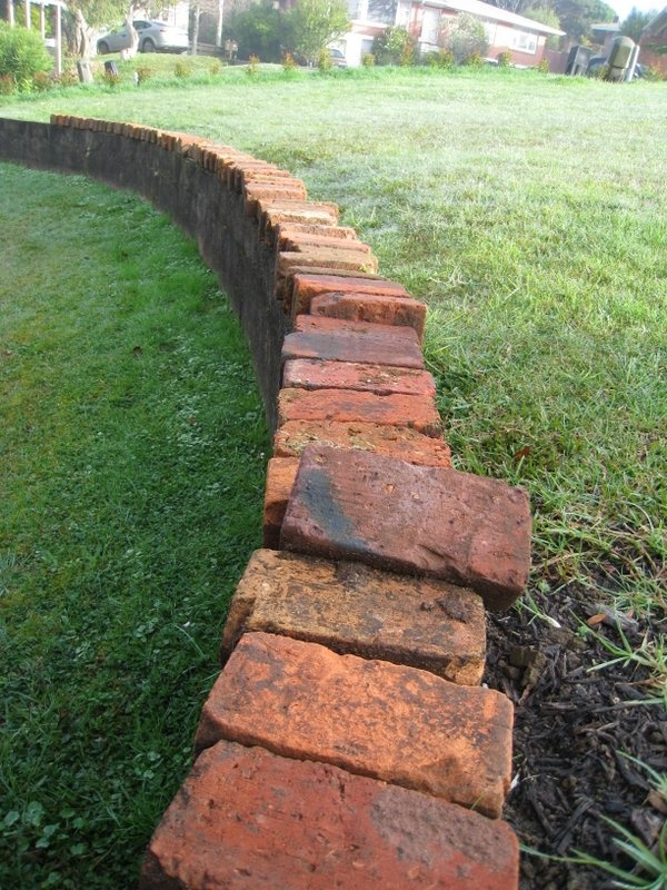 Recycled villa bricks to edge the gardens with.
