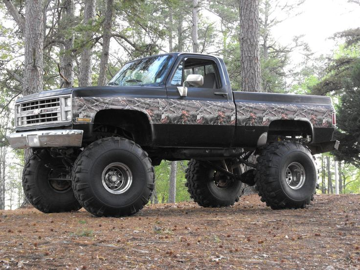 jacked up chevy trucks mudding - photo #22