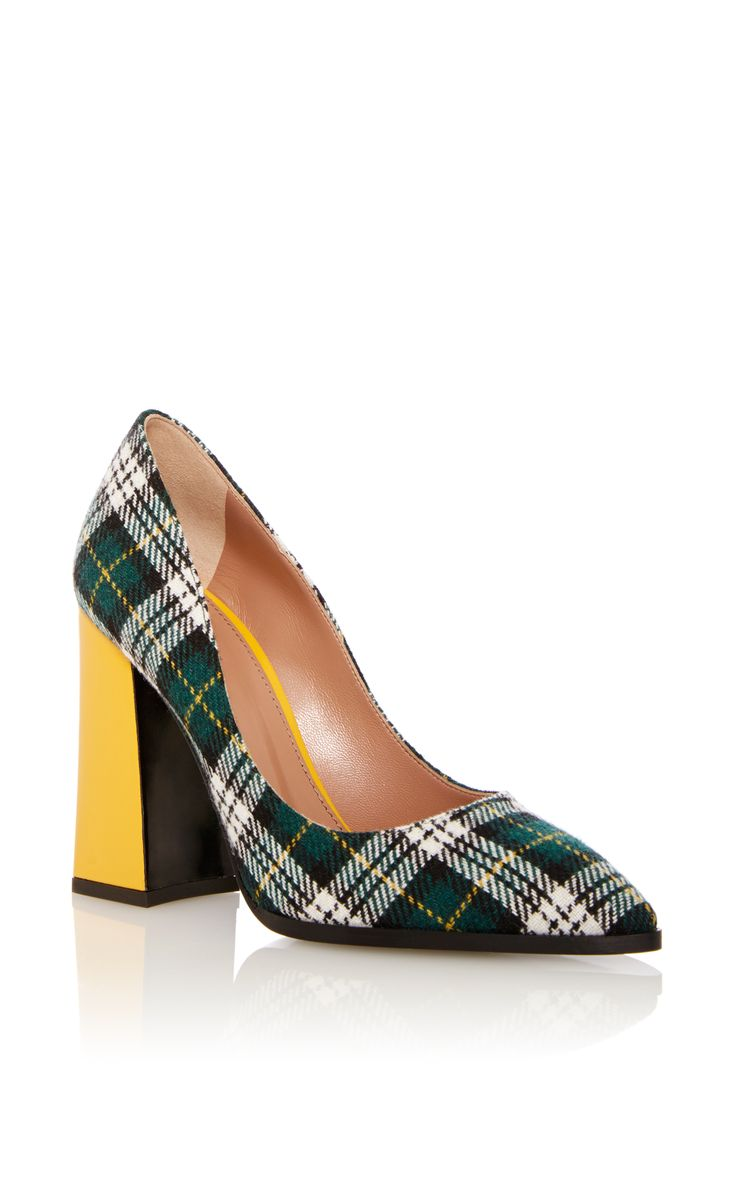 This pump by **Pollini** is rendered in lake kilt plaid and features a  contrasting chunky yellow heel and a pointed toe.