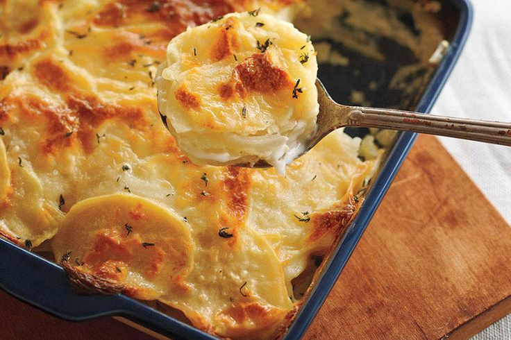 Classic Scalloped Potatoes—With a nice hint of garlic, these potatoes are a delicious addition to any meal and are much lighter than those with a cream-laden gratin. To slice them easily, cut a little piece off the bottom of each potato to stabilize it on the cutting board. Serve with your favourite baked fish or chicken.