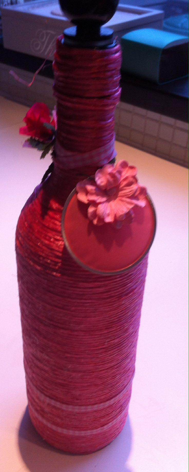 Fles gewikkeld in cisal touw