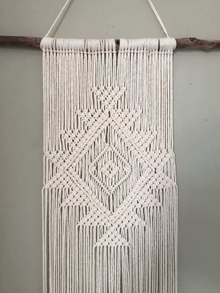 This is a Made to Order product!! It is a lovingly handmade Macrame wall hanging. It will be made especially for you so please allow 3-4 working days to ship. This piece is perfect for giving your home decor that natural, bohemian edge, or would be perfect for an addition to your wedding decor and would match perfectly with aztec style decor or furniture! Its made from 100% cotton and the stick was found on Tynemouth Beach, Newcastle upon Tyne, UK The sticks are handpicked and are one of ...