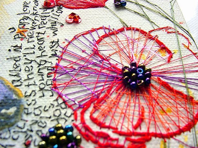 Love the combination of text and objects on this piece of embroidery.