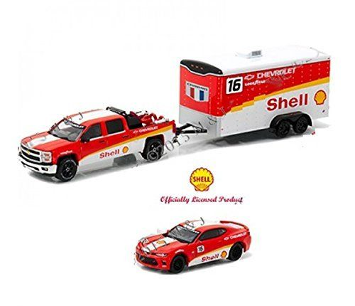 GREENLIGHT 1:64 HITCH & TOW RACING - SHELL - 2015 CHEVROLET SILVERADO & 2016 CAMARO WITH ENCLOSED CAR HAULER 51061-B:   This precision diecast collection is guaranteed to get you revved up for racing. This three piece set includes a covered metal car trailer, pickup tow vehicle and race car. All painted in matching racing color schemes! Features Limited Edition Diecast Fully Licensed & Authorized