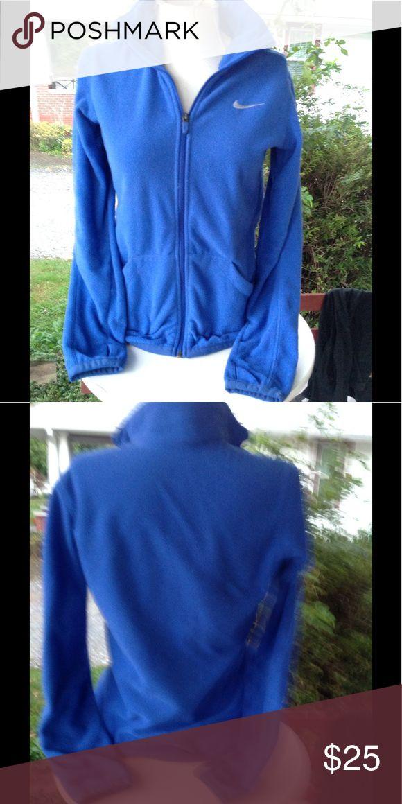 Womans Nike fleece jacket. It is a size medium, blue, a little worn but in good condition. Nike Jackets & Coats