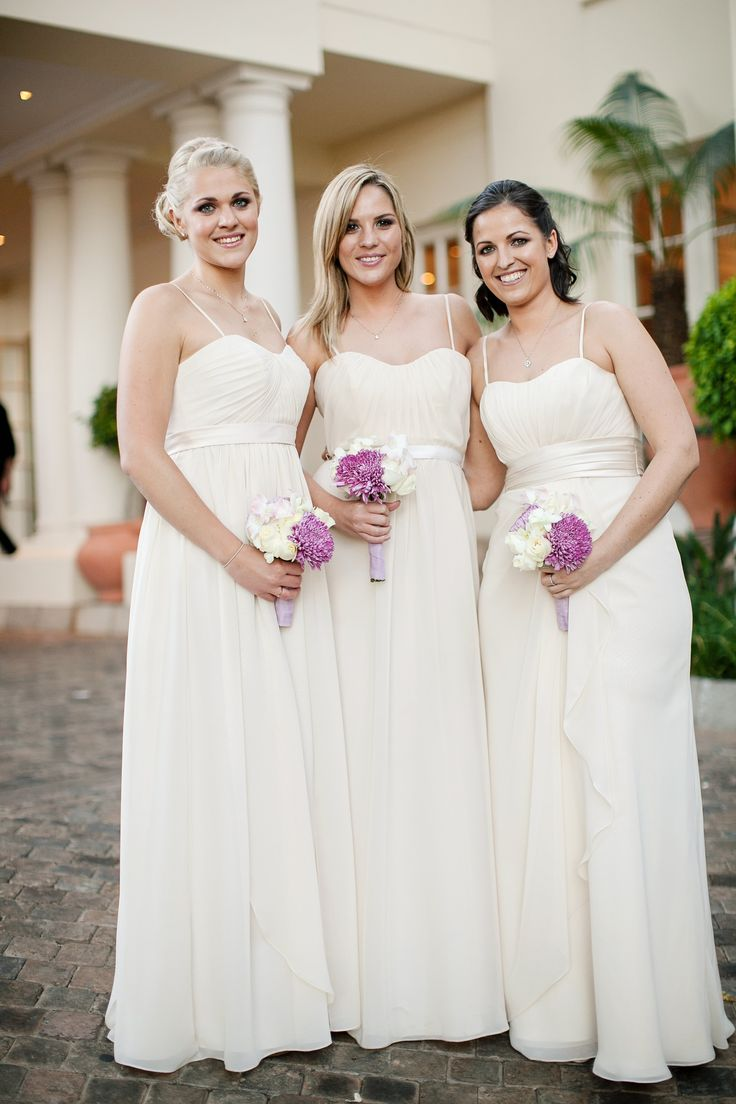 Elegant wedding. Cream bridesmaid dresses. Image by Tyme Photography