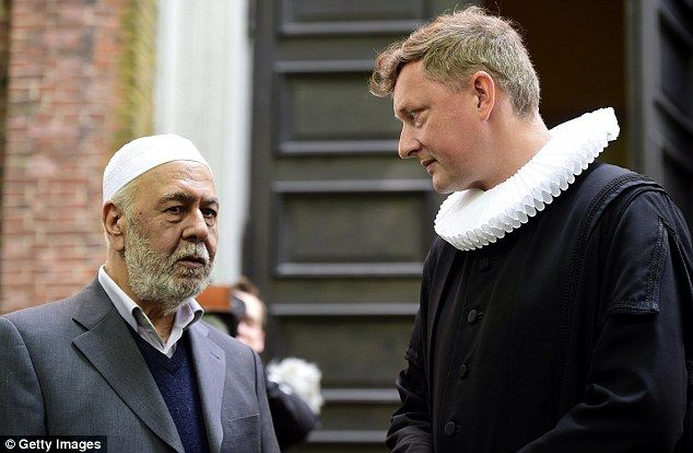 Pastor Sieghard Wilm (right) and Islamic pastor Abu Ahmed Jakobi (left) stand outside St. Pauli Church prior to the interfaith memorial service