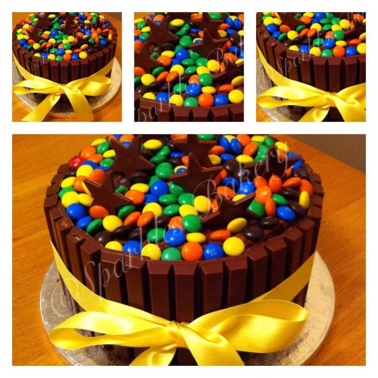 Triple chocolate fudge cake with kitkats and m