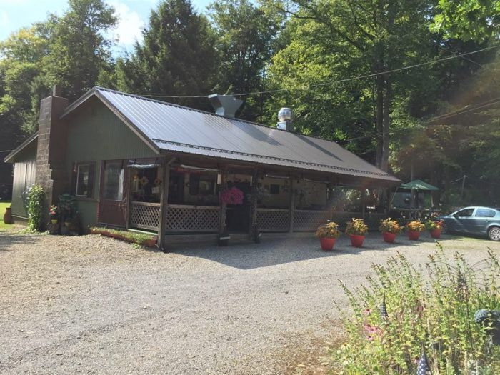 Protected by the forest trees, the Forest Nook Restaurant looks much like a rustic cabin, warm and inviting.