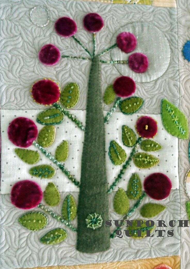 close up, In Full Bloom wool applique quilt, quilted by Sunporch Quilts.  Design by Sue Spargo.