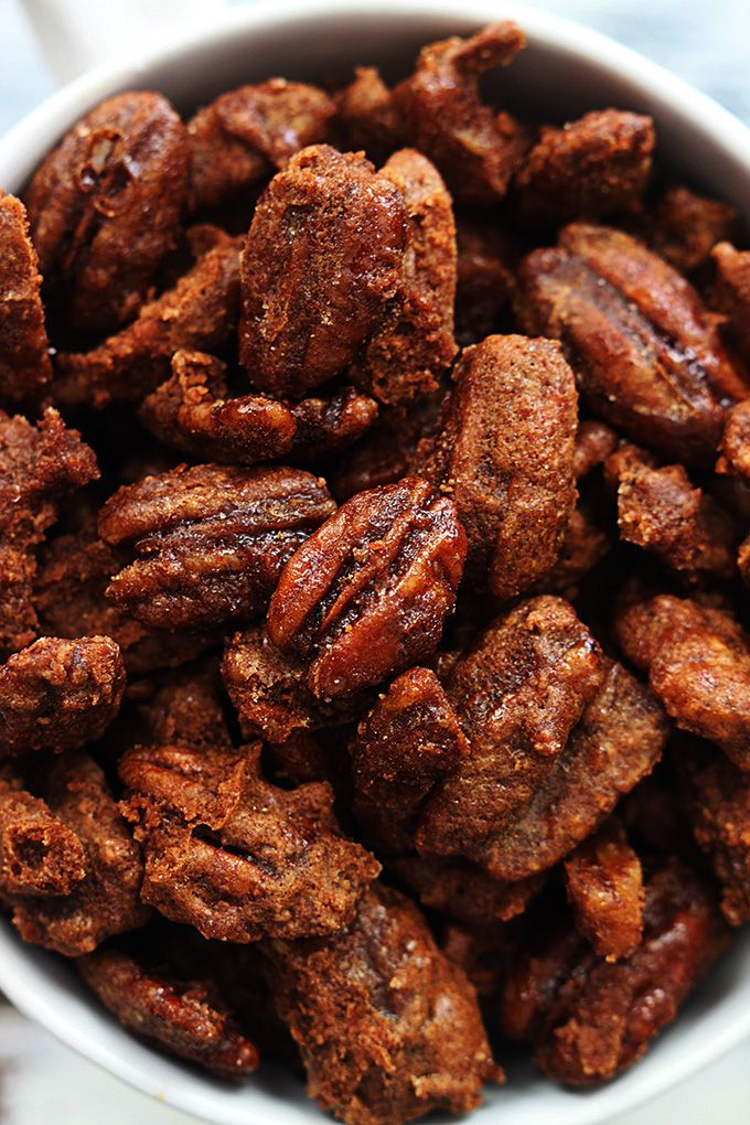 Sugary cinnamon pecans made in your crock pot! These are so easy and dangerously addicting!!