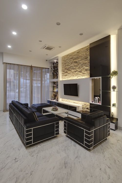Rough sandstone feature wall in living room living for Modern wall design for living room