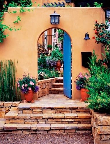 Mexican front door with glimpse into garden