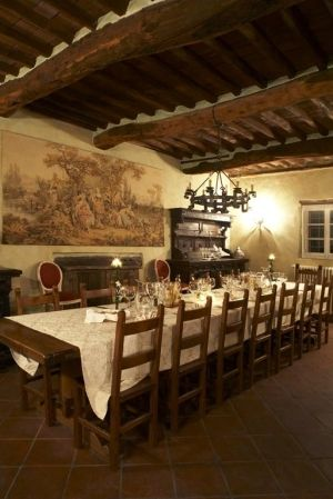 Tuscan Style Dining Room With Wooden Ceiling Beams And Wall Art Chandelier Sconce Large Table Chairs Inviting
