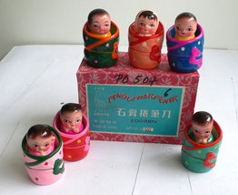 Vintage pencil sharpener set of Chinese babies by seller raygunmann