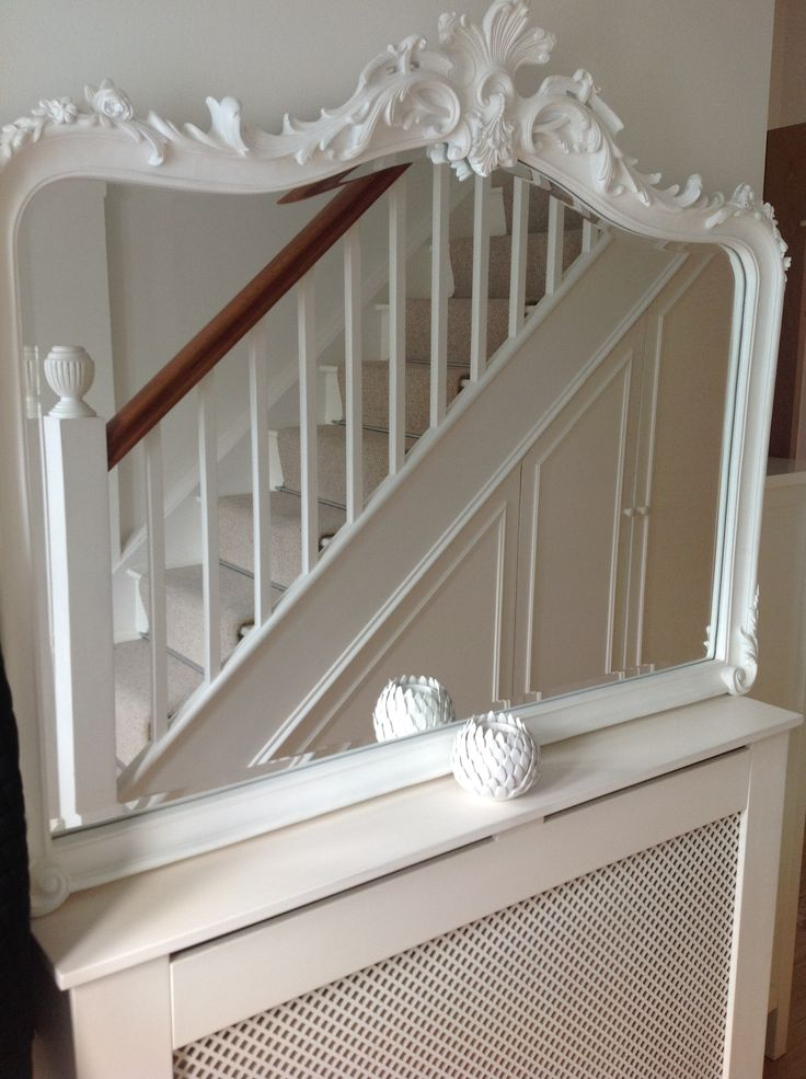 Large white entrance mirror to maximise light, radiator cover to hide those ugly white metal things!